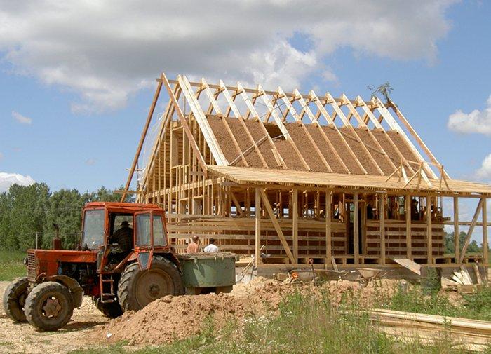 Ein Haus bauen am Land vor blauen Himmel oder: Sondertilgung-Finanzierung-nachtraeglich-moeglich-Hausbau_Stari-Lepel